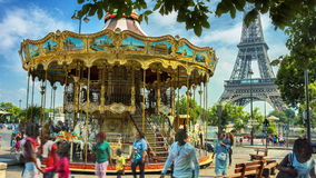 Vintage carousel (merry go round) next to Eiffel tower. Paris, France. Time lapse. 4K stock video footage