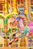 Vintage carousel merry-go-round painted horses. Stock Photo Stock Image