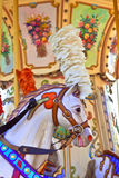 Vintage carousel pony. Portrait of a merry-go-round horse with pink plumage Royalty Free Stock Photo