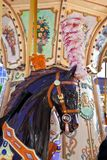 Vintage carousel pony. Portrait of a merry-go-round horse with pink plumage Royalty Free Stock Image