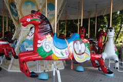 Vintage carousel in a summer park. Royalty Free Stock Images