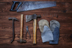 Vintage carpenter's hand tools with a pair of gloves isolated on. Grunge background Royalty Free Stock Images