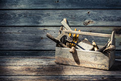 Vintage carpenters tool box. On old wooden table royalty free stock images