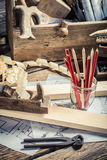 Vintage carpentry workbench and drawing workshop Royalty Free Stock Images