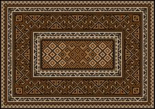 Vintage carpet with ethnic ornament in brown and beige shades Stock Image