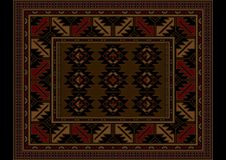 Vintage carpet at maroon and brown shades with pattern in the center. Variegated vintage carpet at maroon and brown shades with pattern in the center Stock Photos