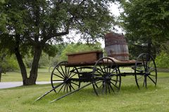 Vintage Carriage. A vintage carriage with a barrel the the road in a park-like setting royalty free stock image