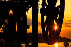 Vintage carriage wheels against the sun at sunse Royalty Free Stock Photography