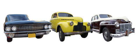 Vintage cars. Three old american cars from diverse years Stock Images