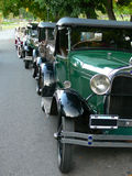Vintage cars. Parked before a parade stock image