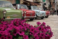 Vintage cars. Italian vintage cars and purple flowers Royalty Free Stock Photo