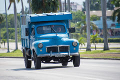 Vintage cars in Action in Cuba Royalty Free Stock Photography