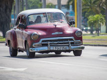 Vintage cars in Action in Cuba Royalty Free Stock Image