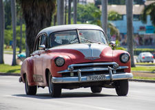 Vintage cars in Action in Cuba Stock Photography