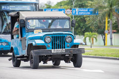 Vintage cars in Action in Cuba Stock Images