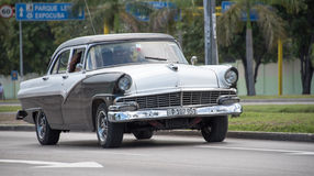 Vintage cars in Action in Cuba Stock Photos