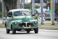 Vintage cars in Action in Cuba Royalty Free Stock Photo