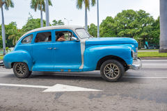 Vintage cars in Action in Cuba Royalty Free Stock Photos