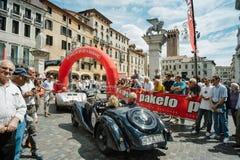Vintage cars. BASSANO DEL GRAPPA, Vicenza ITALY - June 21, 2015. Vintage cars in Freedom Square in Bassano del Grappa, VI - ITALY. The cars and their crews took Stock Photo