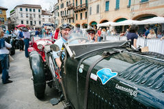 Vintage cars. BASSANO DEL GRAPPA, Vicenza ITALY - June 21, 2015. Vintage cars in Freedom Square in Bassano del Grappa, VI - ITALY. The cars and their crews took Royalty Free Stock Photos