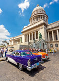 Vintage cars at the Capitol  in Havana. Classic cars in front of the Capitol  in Havana.Cubans keep thousands of them running even when parts have not been made Royalty Free Stock Photos