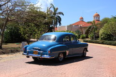 Vintage Cars of Cuba. Classic car driving up to resort in Cuba Royalty Free Stock Photo