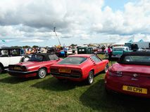 Vintage cars displayed on outdoor green yard. Back view of vintage cars displayed outdoor at Northumberland Wings & Wheels festival at Eshott Airfield north of stock image