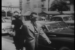 Vintage cars following each other on city street, Los Angeles, California stock video
