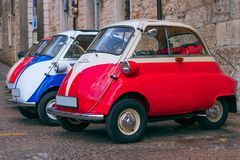 Vintage cars in the italian city stock images