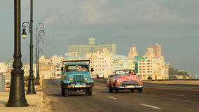 Vintage cars on Malecon  Havana Stock Photos