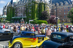 Vintage cars parked in front of the Empress Hotel. Crowds inspect vintage cars parked in front of the Empress Hotel during Northwest Deuce Days in Victoria Stock Images