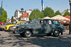 Vintage Saab 95 parked on a market. Old Saab 95 automobilee from 1966 and other retro cars parked in Wejherowo market during old cars race in Northern Poland Stock Photography