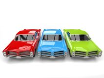Vintage cars in red, green and blue - top down view. Isolated on white background Royalty Free Stock Images