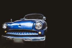 Vintage cars. On a black background stock image