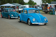 Vintage cars VW Beetle on the road Royalty Free Stock Photo
