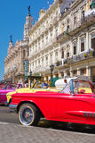 Vintage  cars waiting for tourists next to a hotel in Old Havana Stock Images