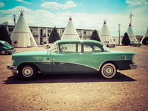 Vintage Cars Wigwam Motel Arizona. Vintage Oldtime Green Vehicle located at Wigwam Motel in Holbrook Arizona royalty free stock photo