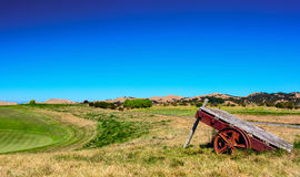 Vintage cart on the golf field. Cape Kidnappers golf court. New Zealand Stock Photo