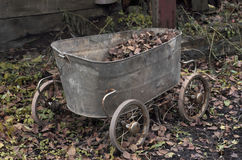 Vintage cart made from an old baby bath Royalty Free Stock Photos