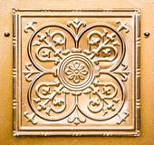 Vintage carving in copper on a door in St. Louis, Missouri. Vintage carving embossed in copper on an old door in the upscale Central West End neighborhood of St royalty free stock images