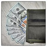 Vintage case contains dollars Stock Photo