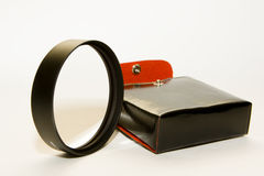 Vintage case and lens ring Royalty Free Stock Photos
