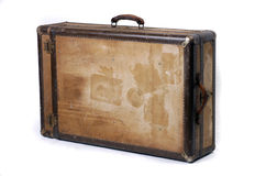 Vintage case steamer trunk. A battered old suitcase shows the traces of luggage labels from world travel royalty free stock photography