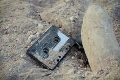 Vintage Casette Tape. A damaged cassette audio tape on the ground Stock Photography