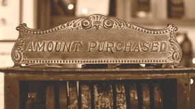 Vintage Cash Register Amount Purchased Sign Cast Iron sepia tone. Shallow Depth of Field Stock Image