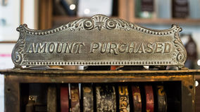 Vintage Cash Register Amount Purchased Sign Cast Iron. Shallow Depth of Field Stock Photo