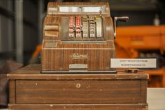 Vintage cash register, old National Till ,with handle to move the tumblers. Old retro money till with cash draw, and finger keys stock photo