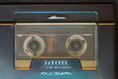 Vintage cassette inside. Playing vintage music deck with focus on cassette royalty free stock image