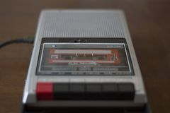 Vintage cassette tape player with audio cassette tape inside. Vintage cassette tape player recorder with audio cassette tape inside Stock Image