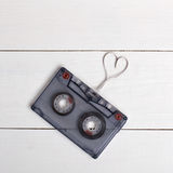 Vintage cassette with tape and shape heart. Valentines Day. Stock Image